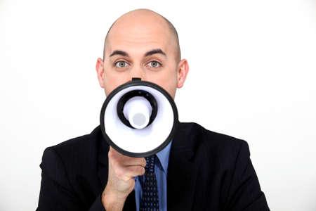 loudhailer: Un hombre de negocios con un meg�fono.