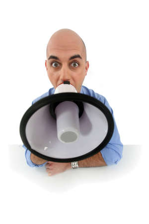 sternly: Bald man shouting into megaphone