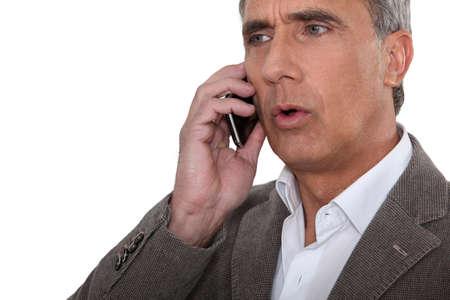 privy: mature man at phone having trouble