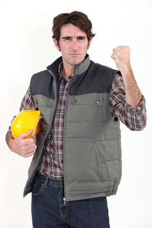 disgruntled: Angry builder waving fist