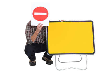 Worker with blank road sign photo
