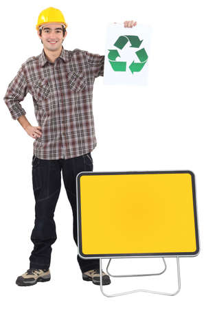 plackard: Manual worker stood with recycle poster