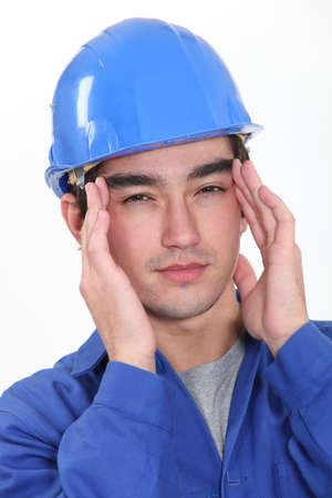 throb: Builder suffering from headache Stock Photo