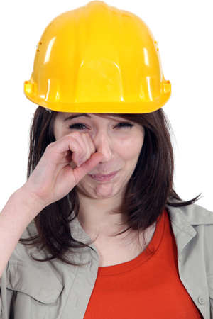 Brunette builder crying photo