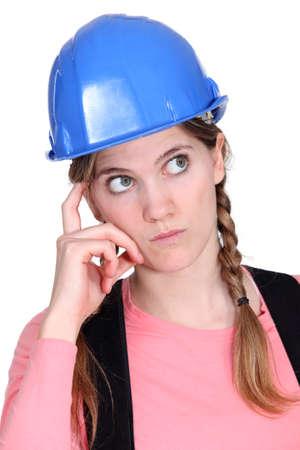 consider: Pensive tradeswoman