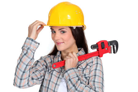 adjustable wrench: Tradeswoman holding a pipe wrench