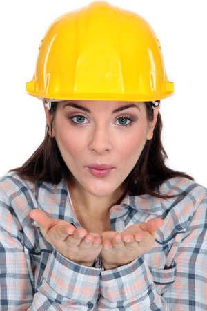 workwoman: Tradeswoman blowing kisses