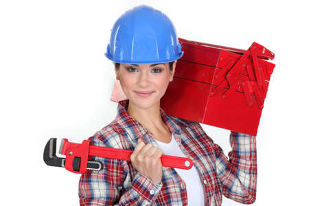Woman carrying tool box on shoulder Stock Photo - 18948307