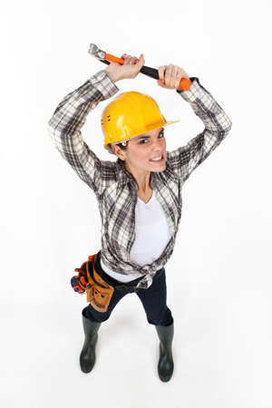 bared teeth: Woman brandishing a hammer