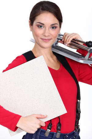 tile cutter: Young woman with a tile cutter