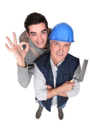 Mason with young apprentice 版權商用圖片
