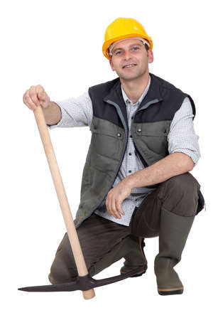 pickaxe: Construction worker with a pickaxe.