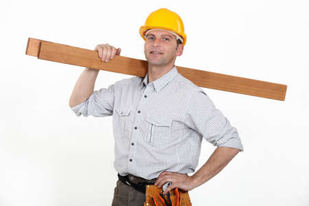 woodworker: Contractor carrying timber Stock Photo