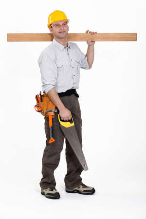 Man carrying plank of wood photo