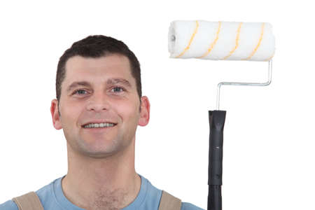 Decorator using roller to paint photo