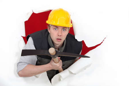 Workman with a pickaxe photo