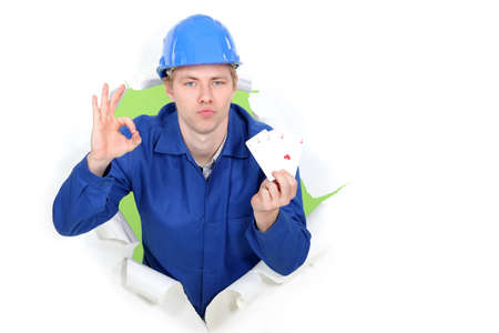 presumptuous: Tradesman giving the a-ok sign and holding up cards