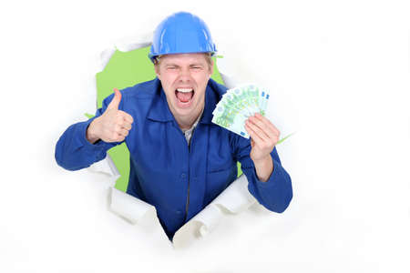 A male construction worker with plenty of cash. Archivio Fotografico