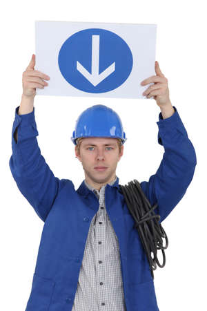 wireman: Electrician holding a one way sign
