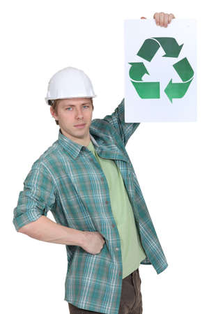 Manual worker holding a recycle sign Stock Photo
