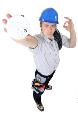 installer: Alarm Installer Stock Photo