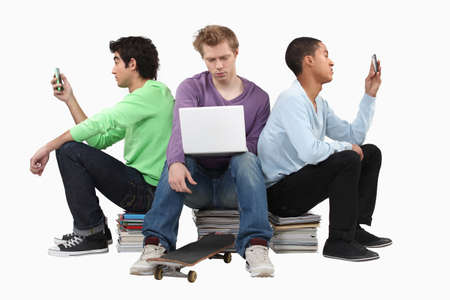 collate: Boys sitting on piles of books