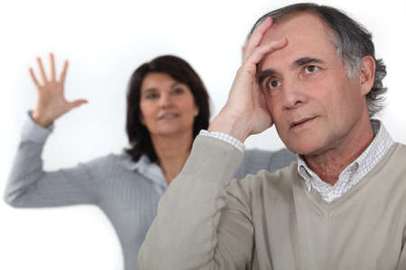 discord: A middle age couple having an argument. Stock Photo