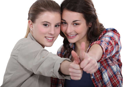 Young women giving the thumb's up photo