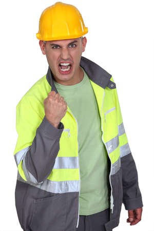 vengeful: Aggressive construction worker rejoicing Stock Photo