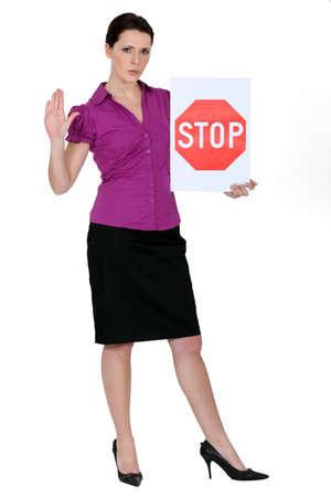 disclaim: Woman with a stop sign Stock Photo
