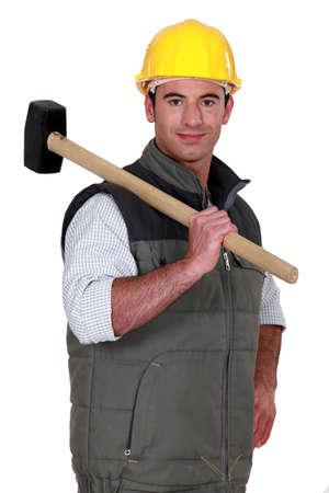 Mason stood with sledge-hammer