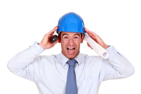 businessman with a helmet having a headache photo