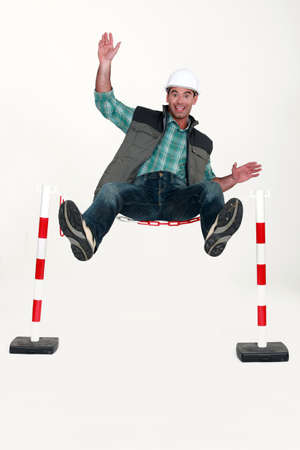 Man jumping over safety barrier Stock Photo - 19144534