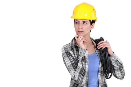 ruminate: Tradeswoman deep in thought Stock Photo