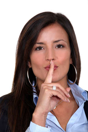 Businesswoman gesturing for silence Stock Photo - 19144847