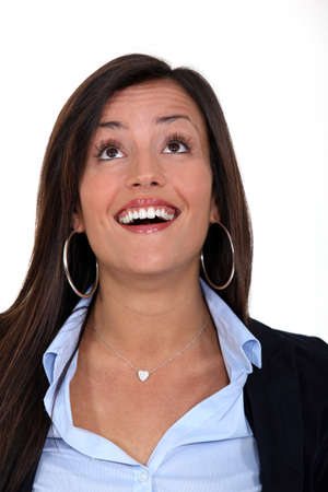 business woman laughing and looking up photo