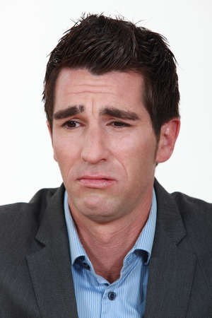 frowned: Businessman frowning. Stock Photo