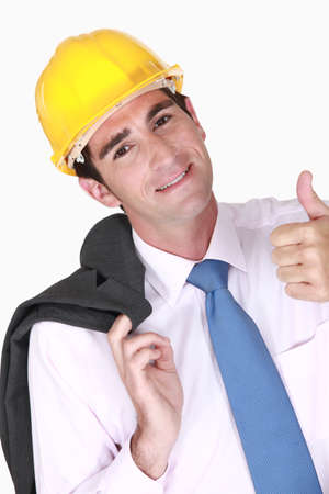 concurrence: Engineer giving his stamp of approval Stock Photo