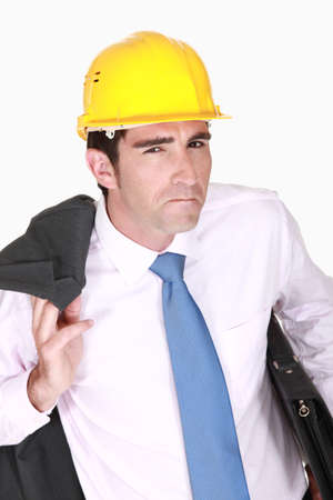 Skeptical businessman in a hardhat Stock Photo - 19144703