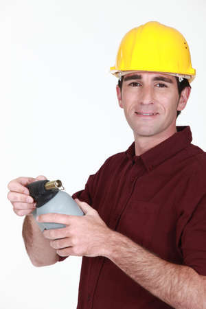 blowtorch: Tradesman holding a blowtorch
