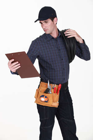 Electrician with a clipboard photo