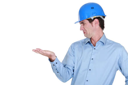 Man with a helmet disgusted by his hand Stock Photo - 19144814