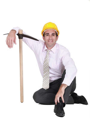 Smiley engineer posing with a pickaxe Stock Photo - 19144446