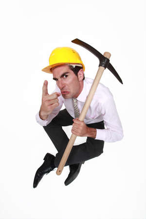 authoritative: foreman with pickaxe looking authoritative Stock Photo