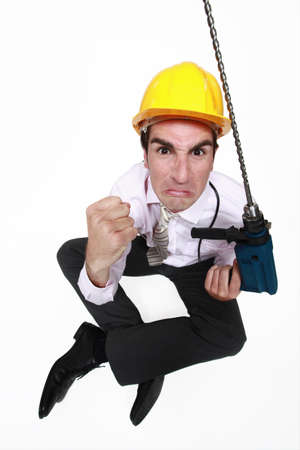 pissed: A pissed architect with a drill. Stock Photo