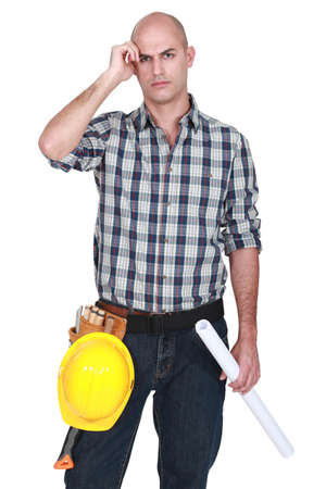 quandary: Engineer scratching his bald head