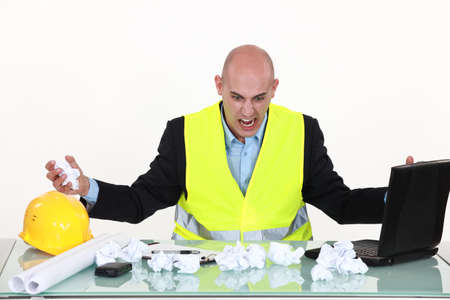 Frustrated engineer at a desk Stock Photo
