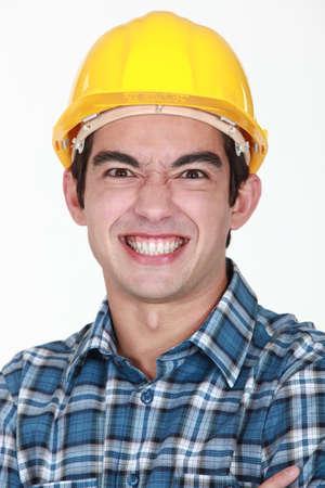 wrinkled brow: Man grimacing