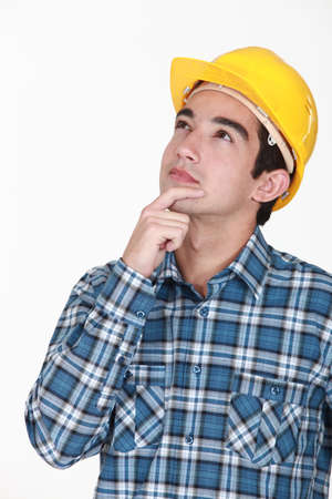 constructors: A pensive looking manual worker. Stock Photo