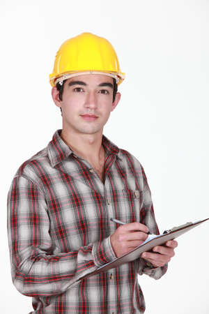 Man in a hardhat with a clipboard photo